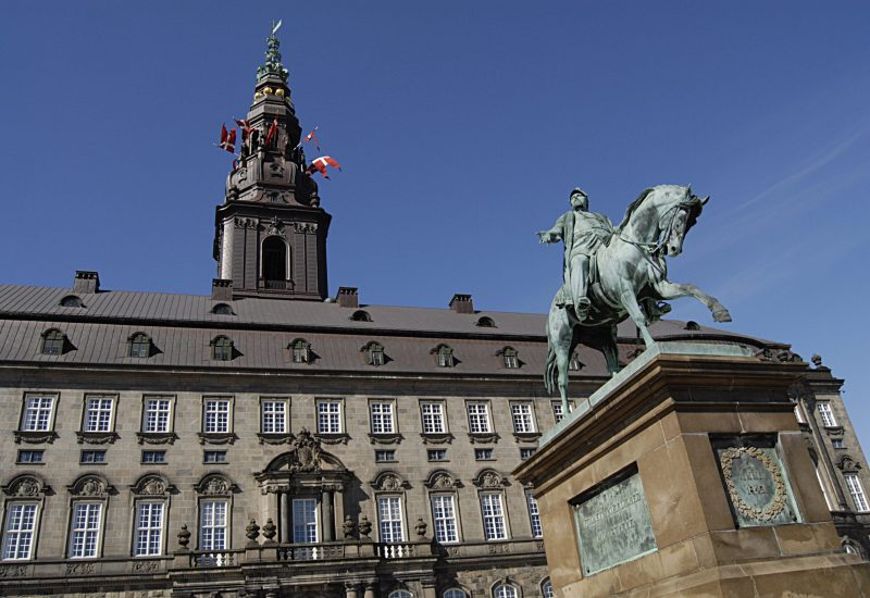 Danish flags/dannebrog flys over chriostians parliament beacuse of danish constitutional day